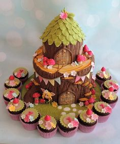 Woodland Fairy Tree Stump Birthday Celebration Cake with cupcakes and toadstools. Woodland Fairy T Tinkerbell Birthday Cakes, Fairy Birthday Cake, 3rd Birthday Cakes, Unique Birthday Cakes, Fairy Garden Cake, Garden Cakes, Fairy House Cake, Woodland Fairy Cake, Toadstool Cake