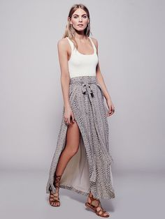 Remember Me Maxi Skirt | Effortless wrap skirt with dramatic side slits for a sweeping fly-away silhouette. Side panels tie around the waist for an easy fit. Lightweight, easy-to-wear fabrication. Lined.