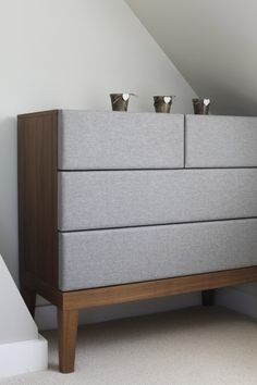 The Lansdowne Upholstered Chest of Drawers, in Heron Grey in our customer Gemma's bedroom. Stylish bedroom storage from MADE.COM/Unboxed
