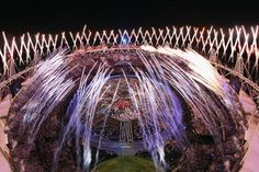 Fireworks go off over the Olympic Stadium during the Opening Ceremony of the London 2012 Olympic Games at the Olympic Stadium on July 27, 2012 in London, England.  (Chris McGrath/Getty Images)  PHOTO LINK