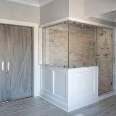 Bathroom makeover - white subway tiles in the shower, the gray flooring -- tiles that look like wood floors. Bathroom Renos, White Bathroom, Master Bathroom, Master Shower, Bathroom Faucets, White Subway Tiles, Grey Tiles, Master Bath Remodel, Half Walls
