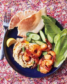 Paprika Shrimp with Hummus and Mint  Boost the appeal of store-bought hummus with fresh mint, then serve it alongside seared paprika shrimp, crisp vegetables, and warm pitas.