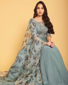 Desi Muse : Nora Fatehi accentuates her charm in aqua blue printed anarkali by Pleats by Kaksha & Dimple WhatsApp us now for personal shopping experience! Bollywood Actress Hot Photos, Beautiful Bollywood Actress, Beautiful Indian Actress, Bollywood Girls, Bollywood Stars, Bollywood Fashion, Actress Photos, Indian Fashion Dresses, Indian Outfits