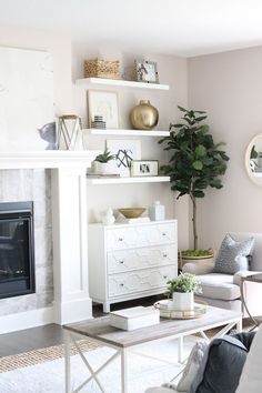 Living Room Reveal {How to Fake Built-In Shelving} Modern-meets-traditional living room tour with lots of white and brass accents. Living Room White, Living Room With Fireplace, New Living Room, Interior Design Living Room, Home And Living, Living Room Designs, Living Room Decor, Living Room Shelving, Cabinets For Living Room