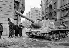Passersby look up at a disabled Soviet tank after the first Soviet departure. People wandered the streets, finding it hard to believe they had driven the enemy away Border Guard, World Of Tanks, Military Photos, Budapest Hungary, Historical Pictures, Life Magazine, Cold War, World History, The Guardian