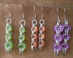 Playful chainmaille earrings around buttons. The aluminum rings of chain were hand turned and very light. They measure approximately two and a half inches from the top of the earring wire down. Cute a