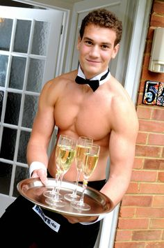 Buff Butlers welcome guests with a glass of bubbly.