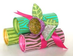 Step 2 - paint to look like logs.   Step 3 - The Glitter Bells -  start by cutting out the egg cups from a recycled egg carton.    give them a coat or 2 of acrylic paint...inside and out.    (you can skip painting if you don't mind seeing carton through the glitter)    slather on some glue and sprinkle with glitter....inside and out.    after they dry poke a hole in the bottom.