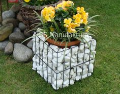 Beautiful handmade gabion in black mat colour is a perfect decoration for Your Garden. Using metal wire gives whole construction durability and
