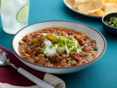 Paula's Slow-Cooker Taco Soup: Paula's meaty bowl features ground beef, pinto and kidney beans, corn and chiles. Serve with cool sour cream, grated cheese and pickled jalapenos for extra layers of flavor.