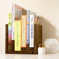 A book case customized for the set of books they hold. No hammering or nails involved!