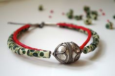 ethnic statement choker necklace with focal vintage afghan silver metal bead, bone and glass beads on Etsy, $65.00