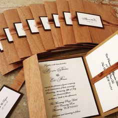 Rustic Wooden Invitation made with Real Mahogany wood! Nice pocketfold card which includes a wooden band, monogram and a pocket to slip your RSVP
