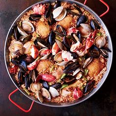 Chicken-and-Seafood Paella | This crowd-pleasing paella from chef Seamus Mullen is cooked on a grill over a live fire, the traditional Spanish way.