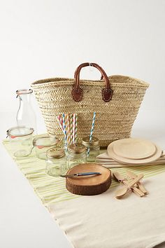 Hillside Picnic Basket Set from Anthropologie.... $232, please...(I believe this is their coveted in store French market shopping bags)... I like the curved tree slice bowl, and the lidded jars, but there's no way this is worth the price- gather your own fun picnic items :)