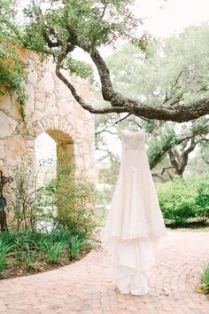 Stunning Enaura Bridal gown: http://www.stylemepretty.com/little-black-book-blog/2014/10/13/elegant-camp-lucy-wedding/   Photography: Mint Photography - http://mymintphotography.com/