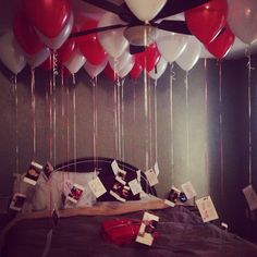 Valentines Day gift idea for him. Hang pictures at the bottom of the balloons and write a memory about it on the back