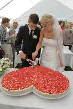 Heart shaped strawberry cheesecake wedding cake!! nice alternative. We had cheesecake at our reception too and it was tiny 1 inch square servings. My husband would have loved this.