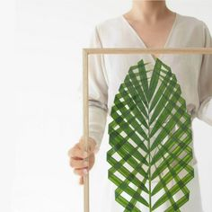 This minimalist approach to botanical art turns a palm frond into an elegant weaving.