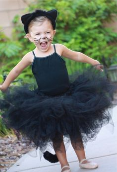 this is pretty close to the costume I am making for Nora this year. long sleve top though and instead of skirt it will be princess cut long tule dress with Orange accent. Her hair will be braidied with ribbon to create a long tail:) and her face paint will be pinned too (check it out).