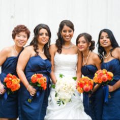 love the Blue brides maids dresses with orange bouquets the only thing i think i would change would be the bride's bouquet it needs blue and orange! :)