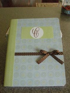 Inexpensive composition books covered in scrap paper