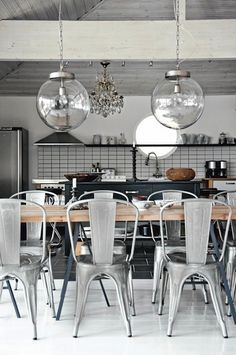 Modern Design: Scandinavian Dining/Kitchen, Open Floor Plan...NOTE: Restored Antique Chandelier and Custom Pendant dropped lighting fixtures, porthole window directly located above Kitchen sink. And LOVE the chairs!