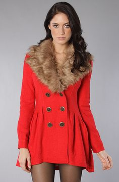 Free People  The Ruffle Peplum Peacoat with removable faux fur collar.