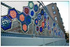 She is taking some lessons from yarnbombing and installation art and putting soft crochet doilies on to hard razor wire urban surfaces, exploring gender through this combination of softness and hardness. Yarn Bombing, Fence Weaving, Guerilla Knitting, Grannies Crochet, Fence Art, Art Yarn, Crochet Art, Guerrilla, Outdoor Art