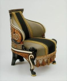 Stunning... Lawrence Alma-Tadema, Armchair, 1884–6, mahogany with cedar and ebony veneer; carved and inlay of several woods, ivory, and abalone shell. Victoria and Albert Museum