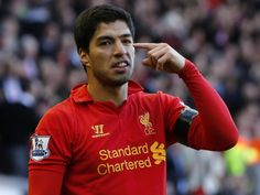 Liverpool's Luis Suarez celebrates his goal against Chelsea during their English Premier League soccer match at Anfield in Liverpool, northe...