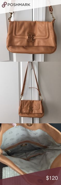 Tory Burch fold over bag - great condition I am re poshing this beautiful Tory Burch bag only because it isn't what I was looking for sadly but it is a great bag in great condition. It can be worn with the top of the bag folded over or strap can be moved to use the bag unfolded. Wear over the shoulder or cross body! Tan color. Outer pocket. 2 inner pockets plus a third with a zip. Magnetic closure. Selling for price I paid. Price is fixed. Tory Burch Bags Shoulder Bags