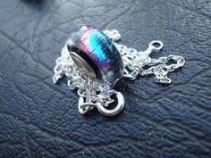 "Glass Donut Bead - Dichroic - Large Core ""                    "" Fine Silver (.999) Core & Sterling Silver (.925) Chain by ArtworxGlassStudio on Etsy"
