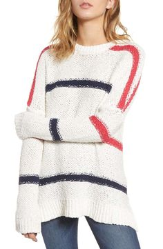 Kick back coast-side in this oversized, chunky-knit striped sweater ideal for staying toasty while the bonfire heats up.