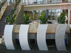 A set of Lunar pots planted with Zamioculcus plants used to provide screening in a recent KZN office installation.