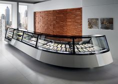 Curved display case layout. Pastry, gelato, low temperature displays. www.AdvancedGourmet.com