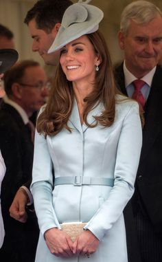 Kate Middleton turns heads in a custom-made powder blue Christopher Kane coat and a matching fascinator hat by Lock and Co.
