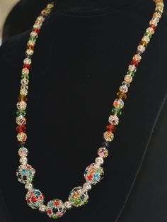 Jewelry..Necklace made of silver plated metal beads loaded with decorative stones in a myriad of beautiful colors...very eye catching! by BarbsBurntTree on Etsy
