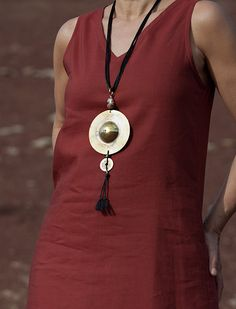 Oriental style: hand hammered and polished brass disk   Oriental style: hand hammered and polished brass disk on silky black cords with a Chinese lucky coin and African bead from Ghana //AMALTHEE CREATIONS