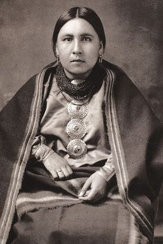 'Osage Woman, C1920.' She is wearing 4 shirt pins; I forgot what a 4th brooch represented. :/ But, 3 brooches = unmarried/no kids; 2 = married/kids; 1 = elderly women. By Granger Art on Demand on artflakes.com as poster or art print $19.41