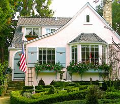 ~deliciously pink cottage with lovely flower boxes~ & oh, those little heart cut-outs in the window shutters~my~