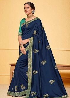 Navy Blue Lace Border Poly Silk Saree Product Details : Saree color is navy blue. Fabric of this designer saree is poly silk. Comes along with raw silk unstitched blouse. Saree has lace border. Ideal for wedding function, party function, festivals Navy Blue Saree, Blue Silk Saree, Raw Silk Saree, Tussar Silk Saree, Chiffon Saree, Embroidered Clothes, Embroidered Silk, Celebrity Gowns, Traditional Sarees