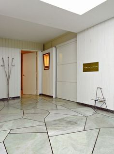 Geometric marble floor in foyer.
