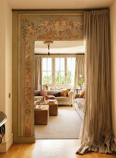 Beautiful painting around doorway~ ElMueble Casa Madrid | Nicety ᘡղbᘠ