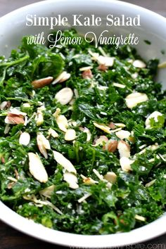Simple Kale Salad with Lemon Vinaigrette - a healthy lunch or dinner for a busy night. Added sliced almonds and parmesan cheese pair perfectly with the tangy lemon dressing.