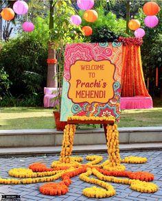 Beautiful floral rangoli at the entrance looks amazing. Indian Wedding Theme, Desi Wedding Decor, Wedding Hall Decorations, Diy Wedding Backdrop, Wedding Entrance, Backdrop Decorations, Flower Decorations, Wedding Ceremony, Mehendi Decor Ideas