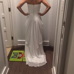 Wedding Gown Never been worn wedding gown! Think beach or garden weddings! Strapless, ivory, chiffon material with back beads detail. Make an offer!! Dresses Strapless
