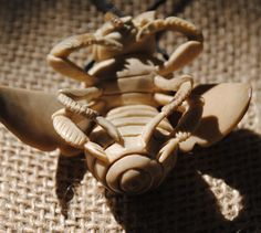 Hand-carved Bee Palm Nut Larg
