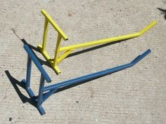 Motorcycle Stands - Homemade motorcycle stands fabricated from square steel tubing.
