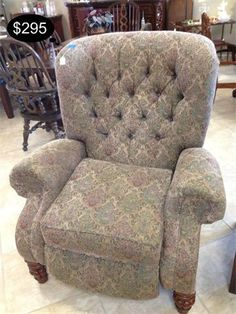 Tan and Maroon tapestry style upholstery low leg recliner in a wing back style.